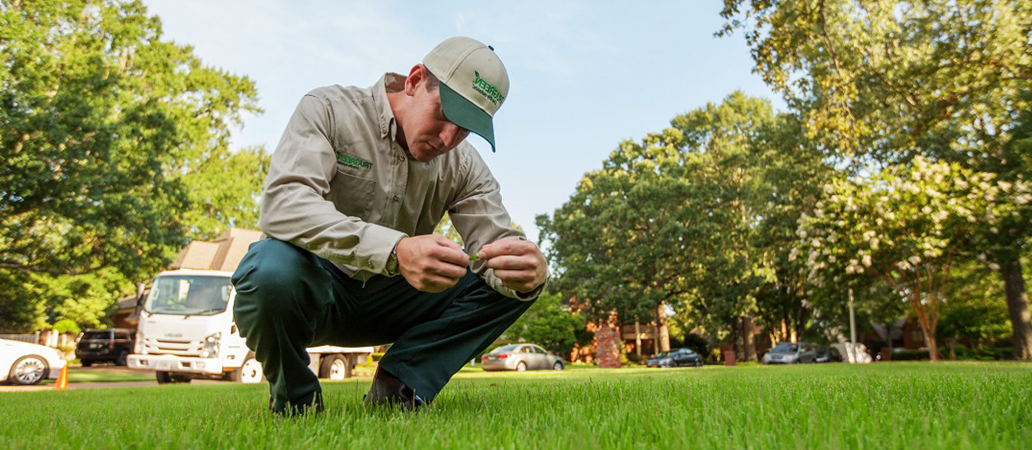TruGreen Certified Specialist inspects a lawn health